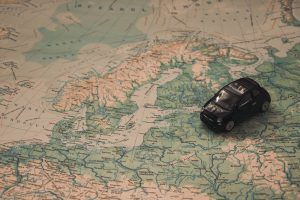 Canva - Black Toy Car on World Map Paper