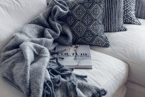 Canva - Couture Book on Sofa